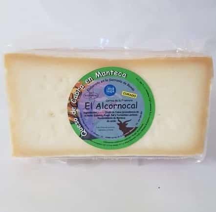 medio queso de cabra curado en manteca iberica